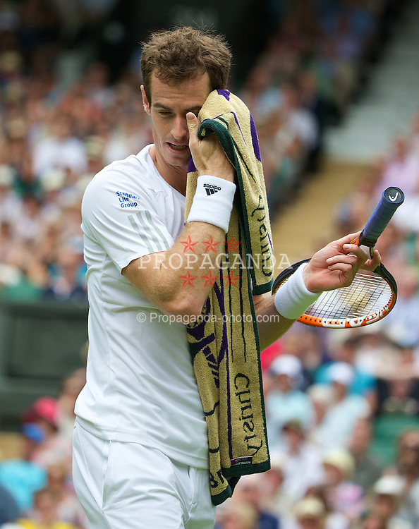 LONDON, ENGLAND - Monday, June 23, 2014: Andy Murray (GBR) during the Gentlemen's Singles 1st Round match on day one of the Wimbledon Lawn Tennis Championships at the All England Lawn Tennis and Croquet Club. (Pic by David Rawcliffe/Propaganda)