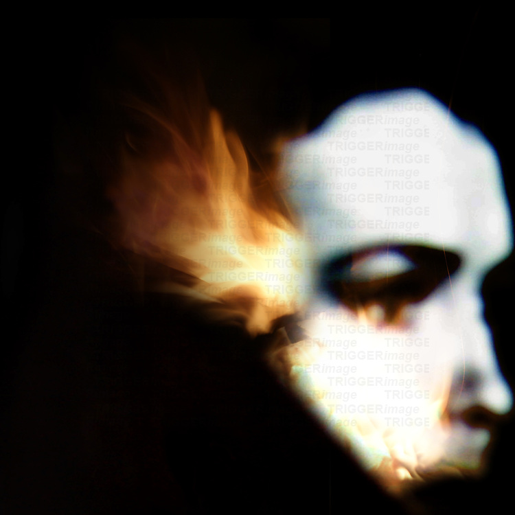 dream scene of a woman's face in profile with flames emanating from her