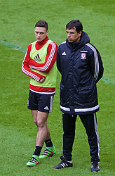 CARDIFF, WALES - Saturday, March 26, 2016: Wales' manager Chris Coleman and James Chester during a training session at the Millennium Stadium ahead of the International Friendly match against Ukraine. (Pic by David Rawcliffe/Propaganda)