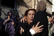 Women mourn during the funeral of the boys who got killed by an Israeli naval bombardment in the port of Gaza cry during their funeral in Gaza City, 16 July 2014. Four boys died on the spot during an Israeli naval bombardment in the port of Gaza, a fifth boy died shortly after the attack in hospital. Israel stepped up its attacks on 16 July by bombing the homes of Hamas leaders after the Islamist movement rejected a truce proposal and instead launched dozens more rockets into Israel.(Photo by Heidi Levine for The National).