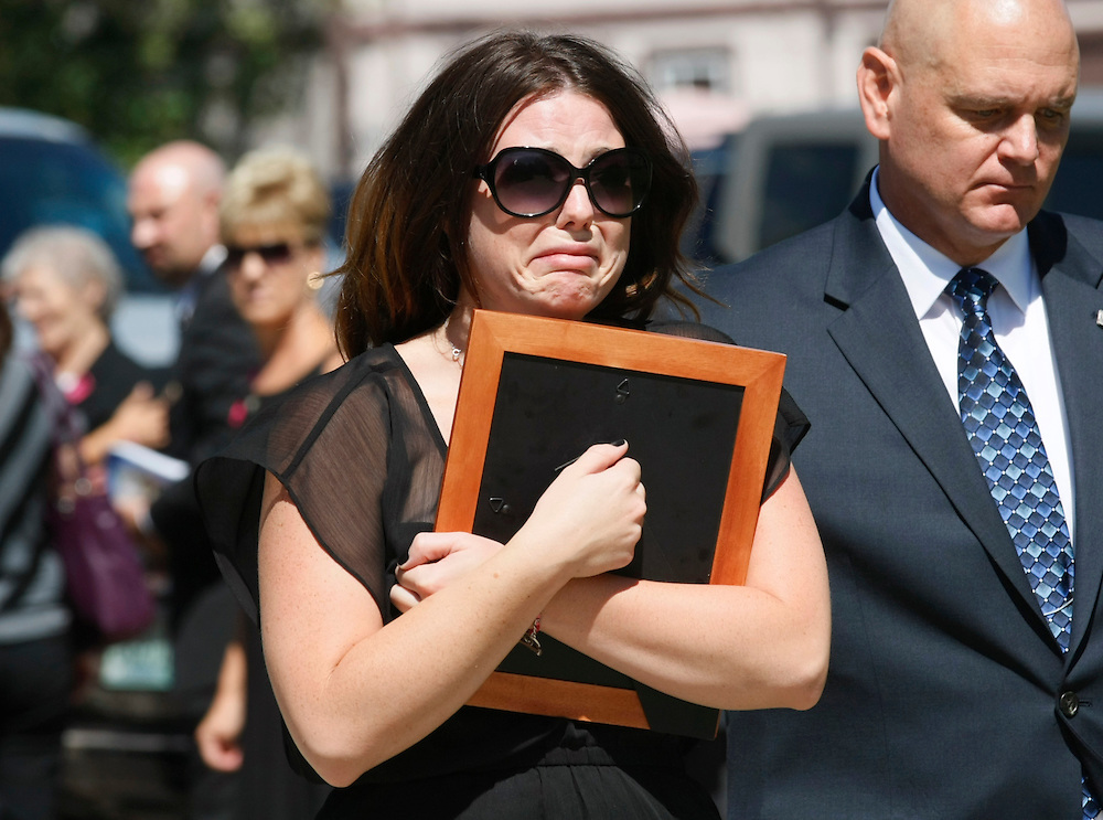 Amanda Medek, sister of Micayla Medek killed in the July 20, 2012 movie theater shooting arrives for her sisters funeral in Aurora July 26, 2012.   REUTERS/Rick Wilking (UNITED STATES)