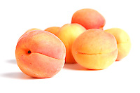 Apricot fruits on white background