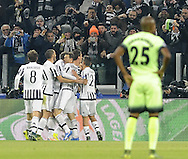 Mario Mandzukic of Juventus celebrates with team mates during the UEFA Champions League match at Juventus Stadium, Turin<br /> Picture by Stefano Gnech/Stella Pictures Ltd +39 333 1641678<br /> 25/11/2015