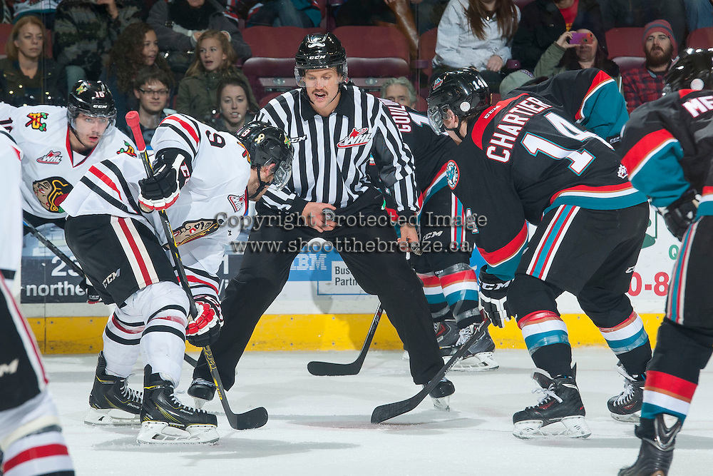 KELOWNA, CANADA - NOVEMBER 22: Linesman Dustin Minty stands at the face-off between the Kelowna Rockets and the Portland Winterhawks on November 22, 2014 at Prospera Place in Kelowna, British Columbia, Canada.  (Photo by Marissa Baecker/Shoot the Breeze)  *** Local Caption *** Dustin Minty; linesman;