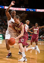 Boston Coll. guard Ayla Brown (1) is defended by Virginia forward Monica Wright (22).  The #21 ranked Virginia Cavaliers defeated the Boston College Eagles 90-70 at the John Paul Jones Arena in Charlottesville, VA on February 22, 2009.
