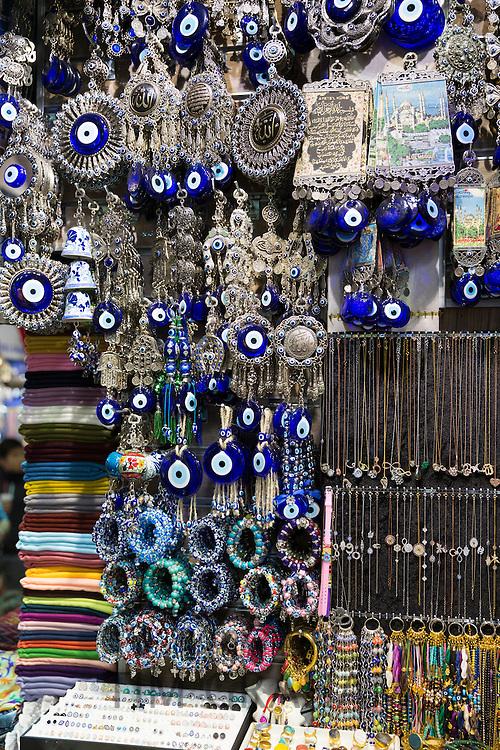 Blue Hamsa Turkish Evil Eye beads pendants and trinkets in The Grand Bazaar, Kapalicarsi, great market, Beyazi, Istanbul, Turkey