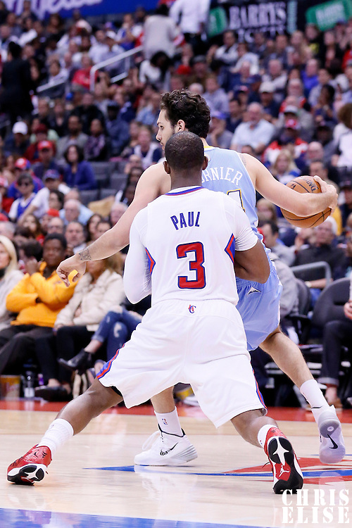 15 April 2014: Denver Nuggets guard Evan Fournier (94) posts up Los Angeles Clippers guard Chris Paul (3) during the Los Angeles Clippers 117-105 victory over the Denver Nuggets at the Staples Center, Los Angeles, California, USA.