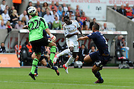 Swansea city's Nathan Dyer © heads over West Ham keeper Jussi Jaaskelainen but sees his header go wide of goal. Barclays Premier league, Swansea city  v West Ham Utd at the Liberty Stadium in Swansea, South Wales  on Saturday 25th August 2012. pic by Andrew Orchard, Andrew Orchard sports photography,