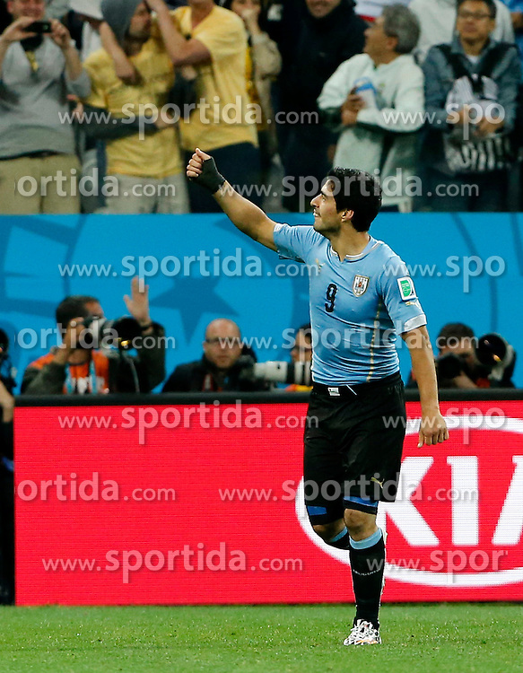 19.06.2014, Arena de Sao Paulo, Sao Paulo, BRA, FIFA WM, Uruguay vs England, Gruppe D, im Bild Uruguay's Luis Suarez celebrates after scoring a goal // during Group D match between Uruguay and England of the FIFA Worldcup Brasil 2014 at the Arena de Sao Paulo in Sao Paulo, Brazil on 2014/06/19. EXPA Pictures &copy; 2014, PhotoCredit: EXPA/ Photoshot/ ZHOU LEI<br /> <br /> *****ATTENTION - for AUT, SLO, CRO, SRB, BIH, MAZ only*****