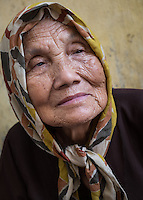 HANOI, VIETNAM - CIRCA SEPTEMBER 2014:  Portrait of old Vietnamese woman in the streets of Hanoi in Vietnam.