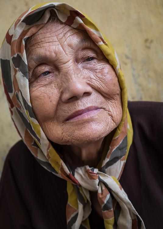 HANOI, VIETNAM - CIRCA SEPTEMBER 2014:  Portrait of old Vietnamese woman in the streets of Hanoi in Vietnam.
