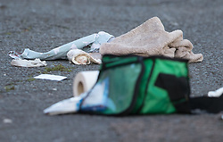 © Licensed to London News Pictures. 30/09/2017. London, UK. Clothing and medical equipment lie in the street after a man was fatally stabbed in Bow, East London. Police were called at 2:30 am on Saturday, 30 September to reports of a disturbance in E3. Officers found a 21-year-old man suffering from stab injuries. He was treated at the scene by London's Air Ambulance before being taken to an east London hospital where he died. Detectives from the Homicide and Major Crime Command are investigating. Photo credit: Peter Macdiarmid/LNP
