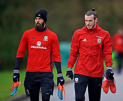 CARDIFF, WALES - Thursday, March 23, 2017: Wales' Joe Ledley and Gareth Bale arrive for a training session at the Vale Resort ahead of the 2018 FIFA World Cup Qualifying Group D match against Republic of Ireland. (Pic by David Rawcliffe/Propaganda)