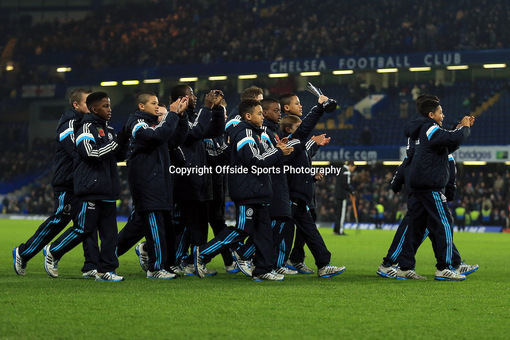 4 January 2015 - The FA Cup 3rd Round - Chelsea v Watford - The Chelsea under 12 squad are paraded around the pitch after wining the Christmas Truce Tournament in Belgium, defeating Paris St-Germain 1-0 in the final - Photo: Marc Atkins / Offside.