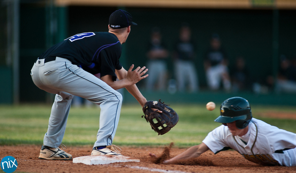 Cox Mill first baseman Luke Pepper waits on the throw as Central Cabarrus' Mason Corzine dives back into the base Friday night at Central Cabarrus High School in Concord. Cox Mill won the game 8-2.  (photo by James Nix)