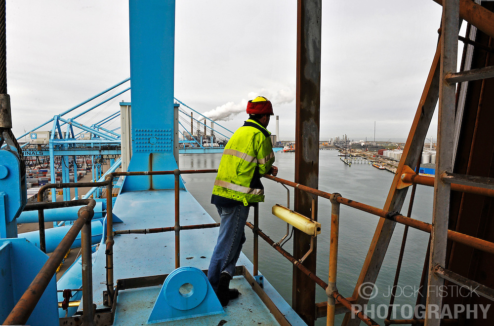 A crane operator at the APM Terminal looks out over the Port of Rotterdam, on Tuesday Oct. 27, 2009, in Rotterdam, the Netherlands. (Photo © Jock Fistick)