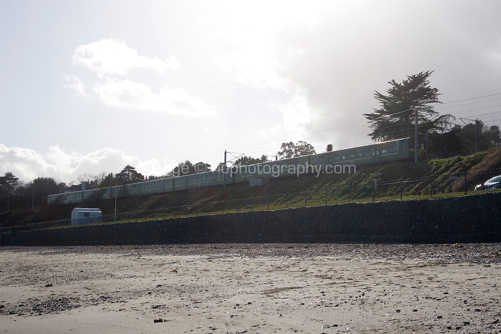 DART train at Killiney Beach in Dublin Ireland
