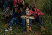 Men mourn during the burial of Emmanuel Cyuzuzo, 22, who passed away before receiving surgery to replace his aortic valve.<br /> <br /> Rheumatic heart disease is damage to one or more heart valves that stems from inadequately treated strep throat.