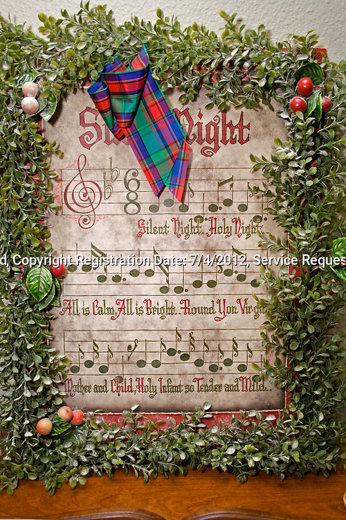 Artistic presentation of the Christmas carol Silent Night framed with a green wreath. St Paul Minnesota MN USA