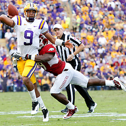 November 25, 2011; Baton Rouge, LA, USA; LSU Tigers quarterback Jordan Jefferson (9) is hit by Arkansas Razorbacks safety Elton Ford (9) forcing a interception during the second half of a game at Tiger Stadium. LSU defeated Arkansas 41-17. Mandatory Credit: Derick E. Hingle-US PRESSWIRE