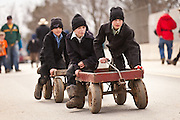 Amish boys ride wagon during the Annual Mud Sale to support the Fire Department  in Gordonville, PA.