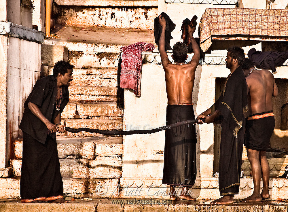 After taking holy bath in river Ganges, pilgrims are drying their clothes on the ghats.<br /> (Photo by Matt Considine - Images of Asia Collection)