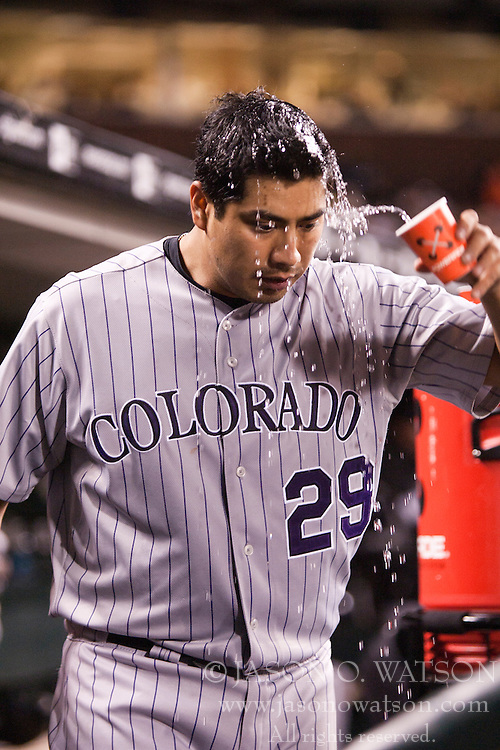 August 30, 2010; San Francisco, CA, USA;  Colorado Rockies starting pitcher Jorge De La Rosa (29) pours water over his head in the dugout during the sixth inning against the San Francisco Giants at AT&T Park.  Colorado defeated San Francisco 2-1.