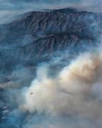 A DC-10 aircraft circles, preparing to drop fire retardant on the mountains below. ©2016 Sivani Babu