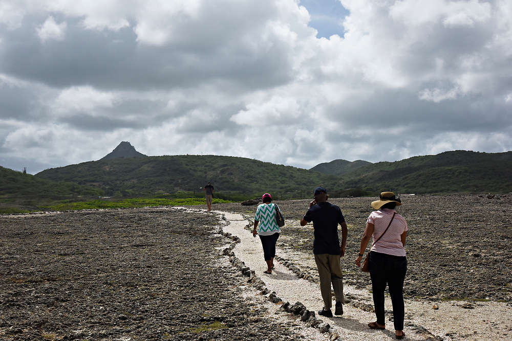 WILLEMSTAD, CURACAO - DECEMBER 12, 2014: Visitors walk down hiking trails at the Shete Boka National Park in Curacao's Westpunt region. (photo by Melissa Lyttle)