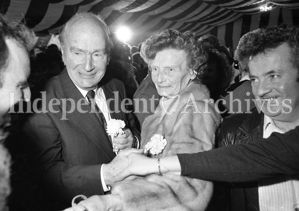 President Dr Patrick Hillery sign's autographs for the staff and crowd at Moneypoint Power Station, Clare, 02/12/1990 (Part of the Independent Newspapers Ireland/NLI Collection).