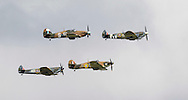 Spitfires and other World War II aircraft take off in formation  from Goodwood airfield near Chichester as the country marked the 75th anniversary of the Battle of Britain. <br /> Picture date Tuesday 15th September, 2015.<br /> Picture by Christopher Ison. Contact +447544 044177 chris@christopherison.com