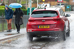 © Licensed to London News Pictures. 06/01/2020. Builth Wells, Powys, Wales, UK. Motorists drive through surface water in Builth Wells, Powys, after heavy rainfall. Photo credit: Graham M. Lawrence/LNP