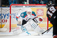 KELOWNA, CANADA - FEBRUARY 28: Jackson Whistle #1 of Kelowna Rockets defends the net against the Calgary Hitmen on February 28, 2015 at Prospera Place in Kelowna, British Columbia, Canada.  (Photo by Marissa Baecker/Shoot the Breeze)  *** Local Caption *** Jackson Whistle;