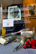 Brussels Belgium 6th December 2013. At the South African Embassy in Brussels people gather, Nelson Mandela died just yesterday.Flowers outside the embassy with a portrait of mandela inside the embassy