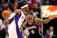 Feb. 23, 2011; Phoenix, AZ, USA; Atlanta Hawks forward Josh Smith (5) guards the Phoenix Suns forward Hakim Warrick (21) at the US Airways Center. Mandatory Credit: Jennifer Stewart-US PRESSWIRE