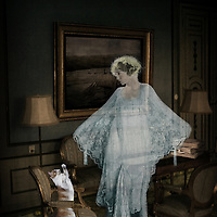 After the tragedy at the koi pond, Lady Dorothy's ghost took up residence in the drawing room.