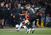 Charlie Goode of Northampton(5) in action with Salford City's Brandon Thomas-Asante(28) during the EFL Sky Bet League 2 match between Salford City and Northampton Town at the Peninsula Stadium, Salford, United Kingdom on 11 January 2020.