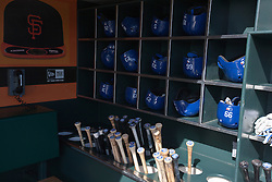 SAN FRANCISCO, CA - APRIL 17:  General view of batting helmets and baseball bats in the Los Angeles Dodgers dugout before the game against the San Francisco Giants at AT&T Park on April 17, 2014 in San Francisco, California. The Los Angeles Dodgers defeated the San Francisco Giants 2-1.  (Photo by Jason O. Watson/Getty Images) *** Local Caption ***