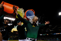 OAKLAND, CA - MAY 07: Mike Fiers #50 of the Oakland Athletics has Gatorade poured on him by teammates after pitching a no hitter against the Cincinnati Reds at the Oakland Coliseum on May 7, 2019 in Oakland, California. The Oakland Athletics defeated the Cincinnati Reds 2-0. (Photo by Jason O. Watson/Getty Images) *** Local Caption *** Mike Fiers