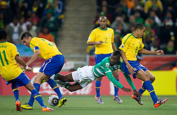 Salomon Kalou of Ivory Coast between Lucio and Gilberto Silva of Brazil during the 2010 FIFA World Cup South Africa Group G Second Round match between Brazil and République de Côte d'Ivoire on June 20, 2010 at Soccer City Stadium in Soweto, suburban Johannesburg, South Africa. (Photo by Vid Ponikvar / Sportida)