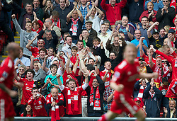 LIVERPOOL, ENGLAND - Saturday, April 23, 2011: Liverpool supporters celebrate as Dirk Kuyt score the second goal against Birmingham City during the Premiership match at Anfield. (Photo by David Rawcliffe/Propaganda)