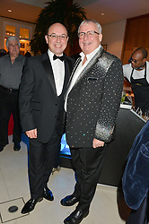 Left to right, NEIL SINCLAIR and CHRISTOPHER BIGGINS at Steps To The Future -in aid of RAFT (Restoration of Appearance & Function Trust) and Walking With The Wounded held at The Hurlingham Club, London on 28th November 2014.