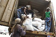 Workers load UNICEF-sponsored domestic kits into a truck for distribution to displaced populations across eastern DRC at a UNICEF depot in Goma, Eastern Democratic of Congo on Monday December 15, 2008. The kits contain blankets, a mosquito net, fabric, tarp, soap, cookware, floor mats and a jerican.
