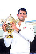 LONDON, ENGLAND - JULY 06: Novak Djokovic of Serbia poses with the Gentlemen's Singles Trophy following his victory in the Gentlemen's Singles Final match against Roger Federer of Switzerland on day thirteen of the Wimbledon Lawn Tennis Championships at the All England Lawn Tennis and Croquet Club on July 6, 2014 in London, England.