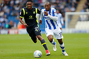 Colchester United's Kyel Reid(17) Carlisle United's Kelvin Etuhu  battles for possession during the EFL Sky Bet League 2 match between Colchester United and Carlisle United at the Weston Homes Community Stadium, Colchester, England on 14 October 2017. Photo by Phil Chaplin