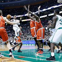 21 December 2012: Boston Celtics point guard Rajon Rondo (9) passes the ball to Boston Celtics power forward Brandon Bass (30) around Milwaukee Bucks center Larry Sanders (8) and Milwaukee Bucks power forward Ekpe Udoh (13) during the Milwaukee Bucks 99-94 overtime victory over the Boston Celtics at the TD Garden, Boston, Massachusetts, USA.