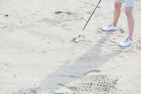 Low section of woman playing at golf course