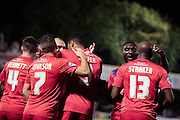 York City celebrate York City forward Vadaine Oliver goal  during the Johnstone's Paint Trophy match between York City and Doncaster Rovers at Bootham Crescent, York, England on 6 October 2015. Photo by Simon Davies.