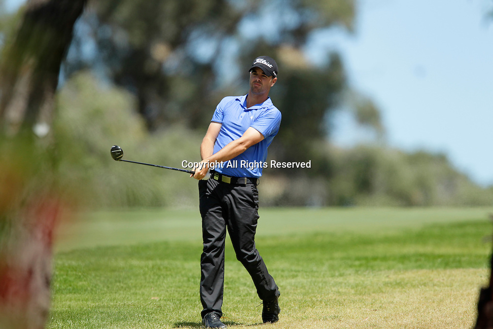 20.10.2013 Perth, Australia. Nick Cullen (AUS) watches his approach shot during the final day of the ISPS Handa Perth International Golf Championship from the Lake Karrinyup Country Club.