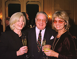 Left to right, MRS CAROLINE KONING, the DUKE OF MANCHESTER and MRS IAN HAMILTON, at a party in London on 27th January 1999.MNN 27